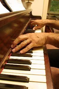 Photo of Edwards on piano