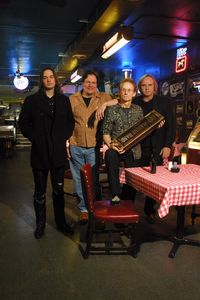 Photo of Lamont Gillispie & the 100 Proof Blues Band. L to r, Gillispie, Mark Stein, Bryon Davies and Andy Brown