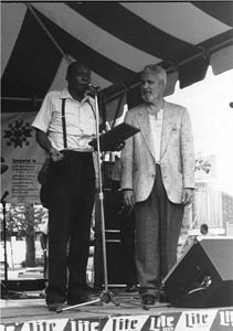 Photo of Henry Woodruff, left, received the Sylvester Weaver Award from Rocky Adock at the 1989 Garvin Gate Blues Festival