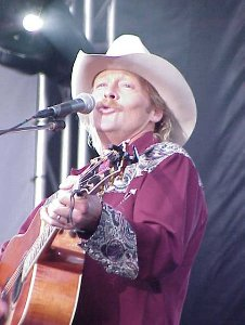 Photo of Towering well over 6-feet tall, Alan Jackson is far from