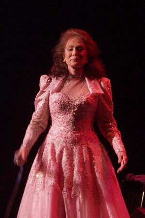 Photo of Loretta Lynn at the front of the stage
