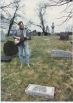 "Photo of Pen Bogert played Sylvester  Weaver's ""Guitar Rag"" at the  headstone dedication in 1992."