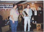 Photo of Keith Clements receives the Sylvester Weaver Award from KBS President Brenda Major at Lisa�s Oak Street Lounge on Nov. 2004.