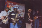 Photo of Rick DeBow, sax and Joe DeBow, guitar, with the band Revenue, at the Mary Ann Fisher Tribute at Stevie Ray�s on Feb. 13, 2005.  Members of Revenue includes Danny Henderson, guitar; Danny Bridges, bass and Ron Graves, drums.
