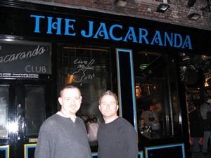 Photo of Pilgrims Kevin and Rob in front of the Jacaranda.