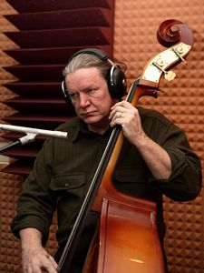 Photo of Michael Price with his 'ears on'