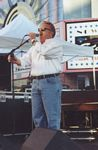Photo of Scott Mullins, emceeing the 1998 Louisville BLues Festival on Theater Square