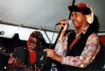 Photo of Ron Lewis, guitar, Izzy Sutton, vocals, Mr. Wonderful Production Band, 10th Street Blues Festival, June 10, 2006